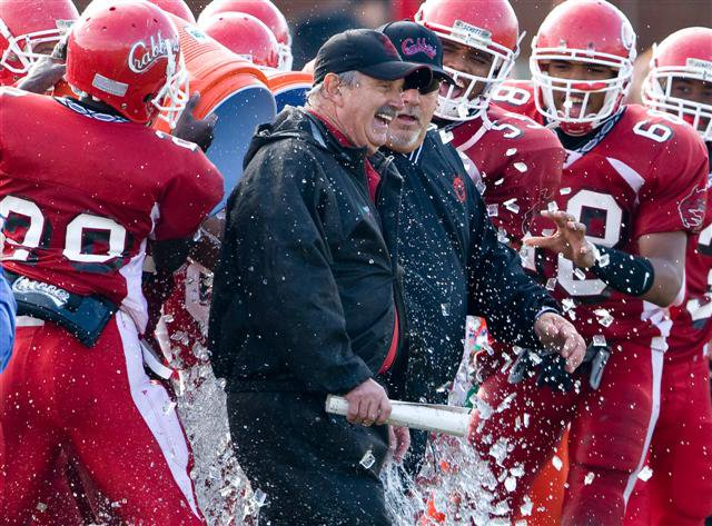 Hampton's Mike Smith is showered after his 400th victory last season.