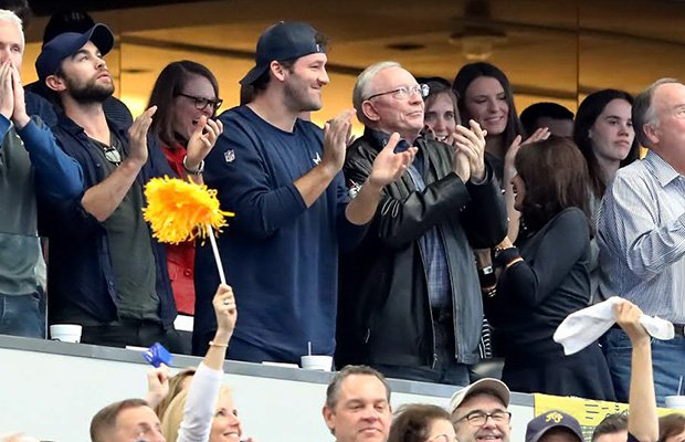 Dallas Cowboys owner Jerry Jones along with quarterback Tony Romo watch Jones' grandson play in the UIL 5A Division I state championship game on Saturday afternoon at AT&T Stadium.