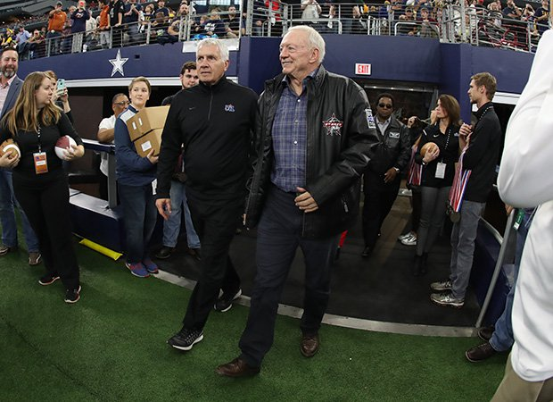 Jerry Jones enters the field at the end of Saturday's title game along with UIL Executive Director Dr. Charles Breithaupt.