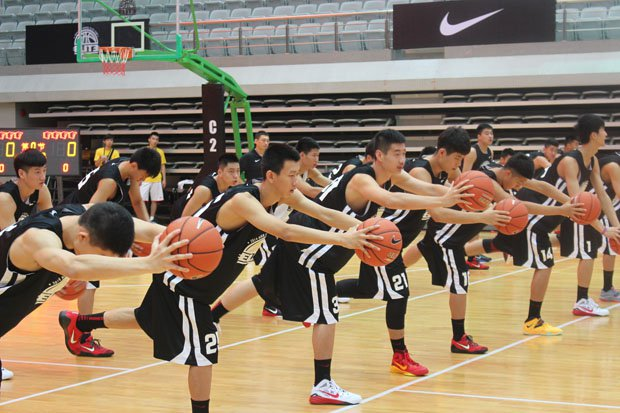 Players from the Nike High School Elite Camp in Shanghai, China, stretch before another day of elite training from three American high school coaches.