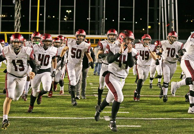 St. Joseph's Prep takes the field against Central Dauphin before the PIAA 6A state title game last season.