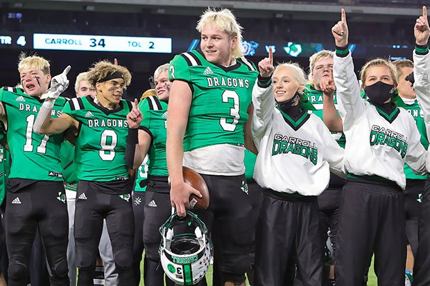 Quinn Ewers celebrates Southlake Carroll's state semifinal win over Duncanville with teammates and cheerleaders in January.