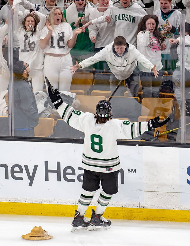 Friend Weller of Duxbury (Mass.) celebrates his hat-trick with fans during his team's victory over Winchester in the MIAA Division 1 state championship game.