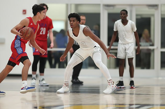 Josh Christopher defends in a December tournament game against Los Alamitos.