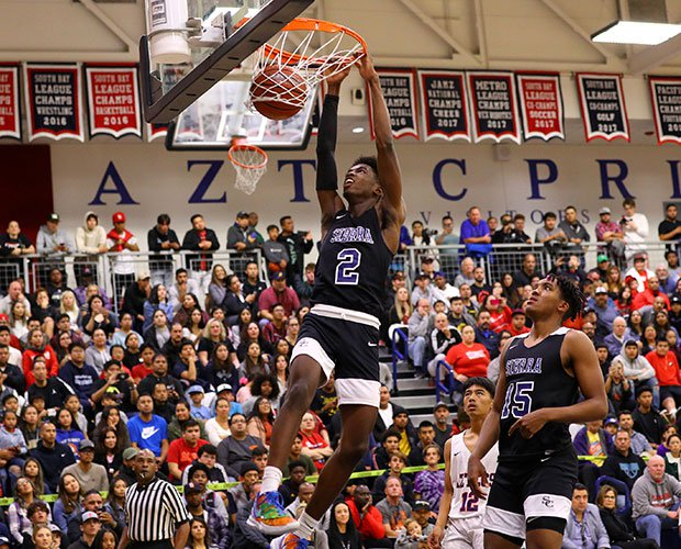 Zaire Wade throws down for two of his six points Thursday night.