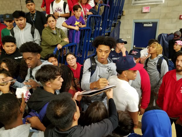 Future Kentucky Wildcat B.J. Boston signs autographs after pumping in a game-high 22 points.