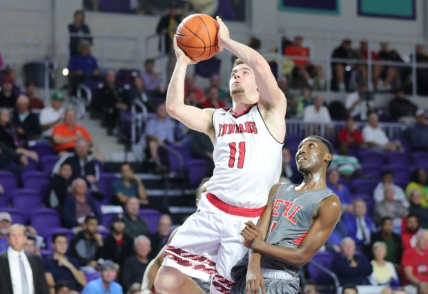Joe Girard scored 50 points on Saturday, including the game-winning shot in overtime, leading Glens Falls to its first New York state title.