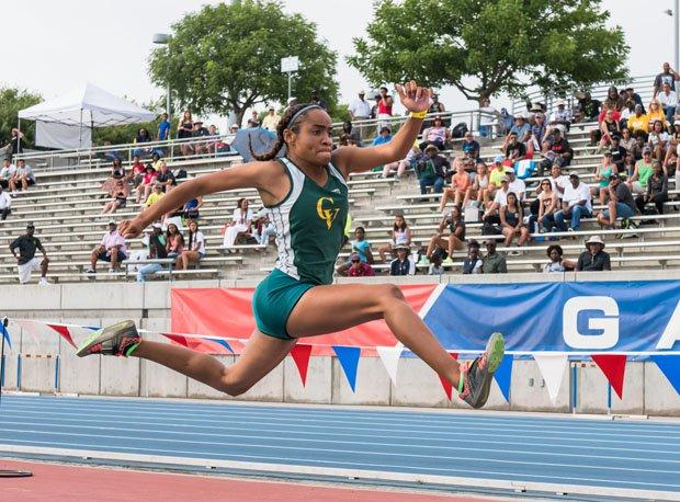 Kennedy Jones in flight en route to her state-winning jump.
