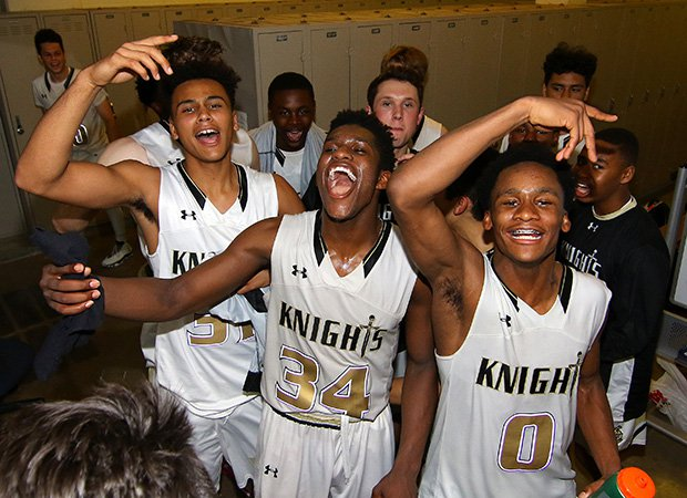 Guard David Singleton (center) leads his Bishop Montgomery teammates  while celebrating in the locker room following their victory over Chino Hills on Tuesday night.