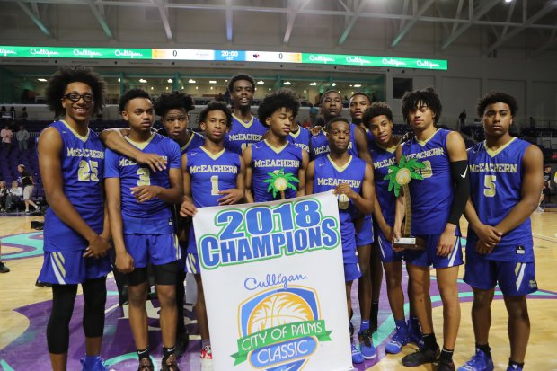 McEachern poses with the championship banner after winning the City of Palms Classic.