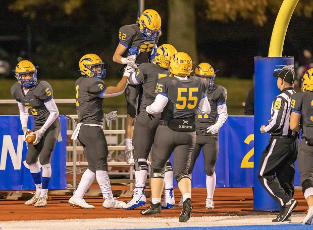 Carmel celebrates during the 2019 season. Indiana announced it planned to resume high school sports activities on July 1.