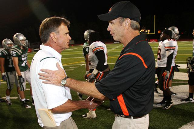 Legendary coaches Bill Castle (right) and Bob Ladouceur congratulate each other after epic overtime game.