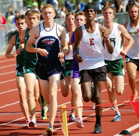 Dakota Ridge senior Danny Carney, left, and Denver East sophomore Cerake Geberkidane, right, lead the pack during the Class 5A boys 3,200-meter final. Fort Collins senior Griffin Hay, in purple, pulled off the victory with a sprint down the stretch Thursday.