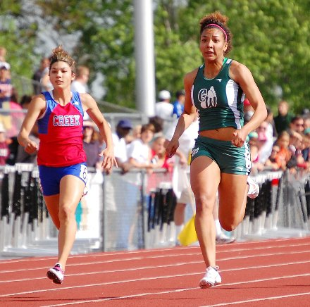 George Washington sophomore Chyna Ries, right, and Cherry Creek junior Emily Romo sprint to the finish during the preliminaries of the Class 5A 100 meters at Jefferson County Stadium.