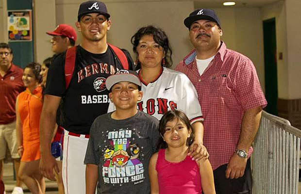 Kerman pitcher Carlos Salazar (left), who was drafted 102nd overall by the Atlanta Braves, and his family can celebrate another postseason honor: MaxPreps 2013 Small Schools Player of the Year.