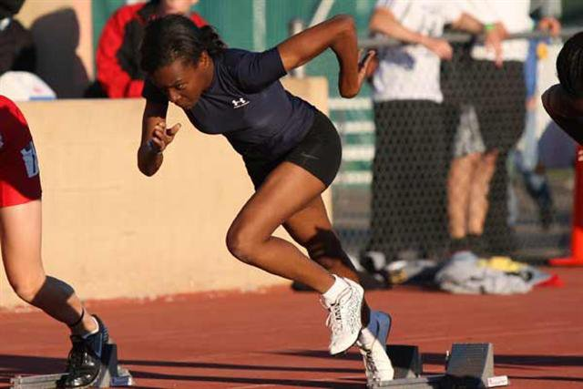 Inderkum senior Brittany Adams explodes out of the blocks during Friday's 100 finals.