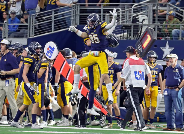Highland Park's Brock Bakich (35) begins to celebrate his team's third straight state title.