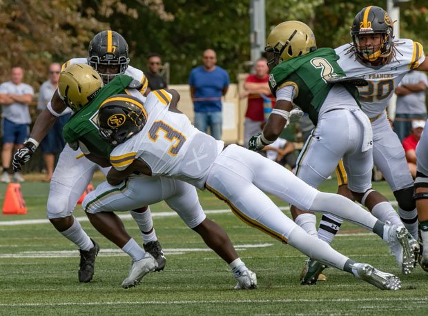 St. Frances Academy's Demon Clowney (3) with a big tackle in the backfield.