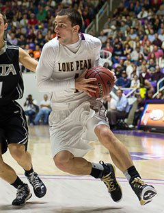 Playing with a broken thumb on his shooting hand, Nick Emery scored 13 points in his final game at Lone Peak.