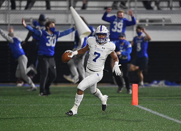 St. Xavier wide receiver Jalen Patterson celebrates  the third of his four first-quarter TD catches as the Bombers beat Pickerington Central 44-3 in the Ohio Division I title game on Friday night.