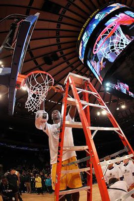A Montverde Academy player cuts down the nets at Madison Square Garden.