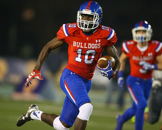 Folsom receiver Joe Ngata scores on a 49-yard touchdown reception during the first half.
