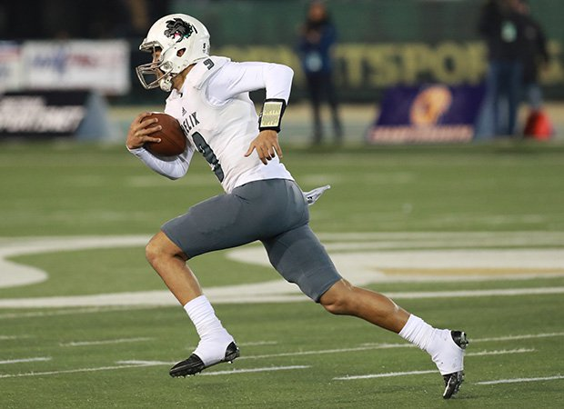 Helix quarterback Carson Baker breaks into the open during the first half.