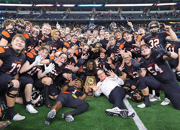 Aledo head coach Tim Buchanan and his players celebrate winning the school's 10th state football championship.