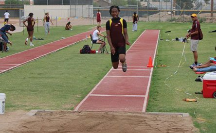 Travonn White, shown here in the triple jump, has matured emotionally and is aiming for glory in the high jump.