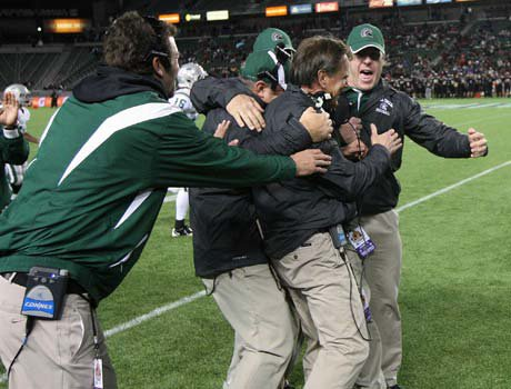 The coaching staff at De La Salle embrace Bob Ladouceur after Pepe Vitale's game-clinching touchdown in the final seconds of Saturday's 48-28 win over Centennial in the CIF Open Division championship. Afterward, Ladouceur said it might be his last game as head coach for the Spartans and he will make that decision after Christmas.