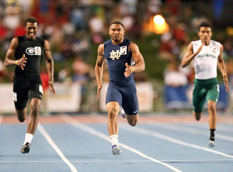 Khalfani Muhammad cruises to victory in his 200 heat en route to the day's best time.