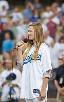 Mackenzie Luderer, granddaughter of  Vin Scully, sang the national anthem at Dodger Stadium.