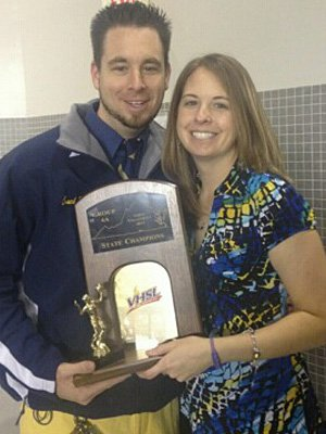 Jenica Brown with her brother Jarod, holding the state championship trophy.