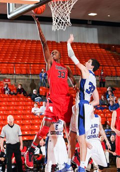 Turner attacks the bucket during a December game against Nolan Catholic of Fort Worth.