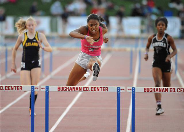 Carter overcame a so-so trials on Friday to bring home two hurdles championships.