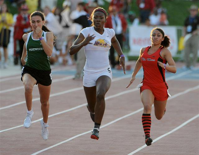 Droughn (right) got off to another superb start and held off a hard-charging Davis (middle) in the 100 finals.