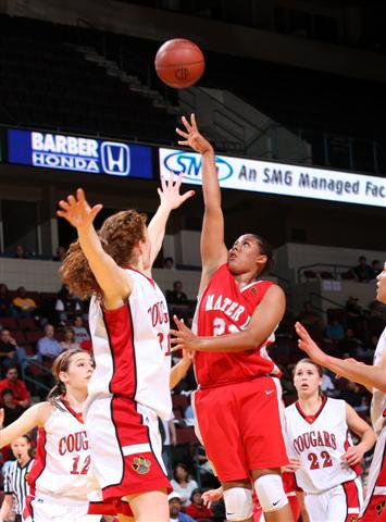 Kaleena Mosqueda-Lewis shoots over long arm of Carondelet.