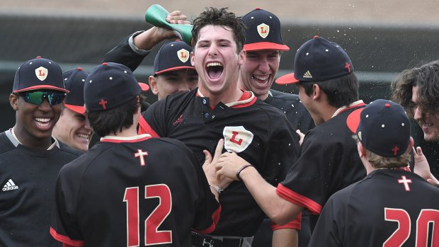 Composite No. 1 Orange Lutheran celebrates an extra innings victory over league rival Servite on April 20.