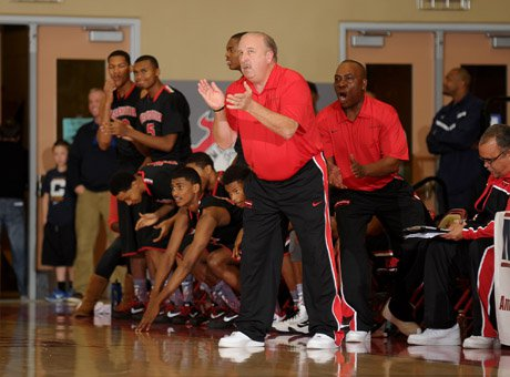 Westchester coach Ed Azzam and his team enjoy the moment late in a 70-62 win over nationally ranked Fort Bend Travis in the finals of the MaxPreps Holiday Classic Invitational Division.