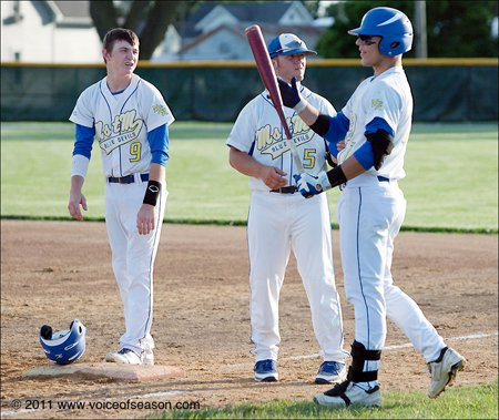 Martensdale-St. Marys coach Sean Smith with seniors Ethan Westphal (left) and Dillon Coates (right).