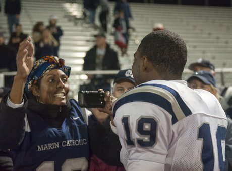 The moment of truth: Akili Terry takes family pictures following regional championship win over Sutter in Oroville.