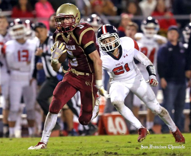 Cardinal Newman senior Kyle Carinalli sprints toward the end zone during a game-winning 42-yard touchdown play to give the Cardinals a 29-28 NCS semifinal win over Rancho Cotate on Nov. 25.
