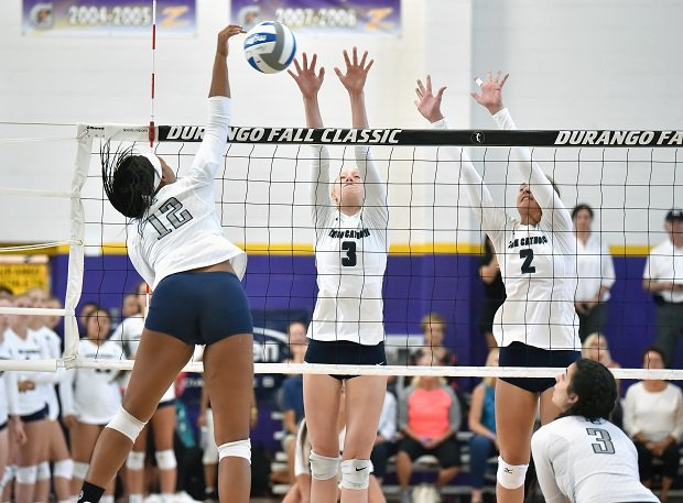 Sierra Canyon's Sidney Montgomery goes up for a kill against Marin Catholic's Grace Olivia and Malia Gassaway earlier this year. Both are in the MaxPreps Top 25.