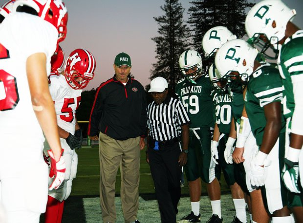 San Francisco 49ers' head coach Jim Harbaugh at a different sort of coin toss than he's used to.
