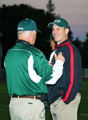 49ers' coach Jim Harbaugh enjoys a moment with his former high school coach and  current Vikings' head coach Earl Hansen.