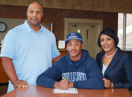 Derrick May Jr., shown with his parents signing his National Letter of Intent to Villanova, never felt pressured to play baseball. But with a father and grandfather who played professional ball, it's no surprise that the Delaware star aims for the big leagues.