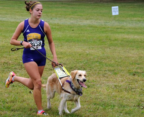 Sami Stoner and her seeing-eye dog Chloe were the first six-legged competitors in an Ohio High School Athletic Association cross country race.