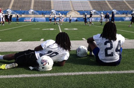 The Griffin brothers, Shaquem (left) and Shaquill enjoy a break during a U-19 practice at Kelly Reeves Athletic Complex in Austin on Sunday.