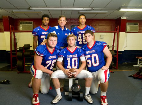 Curtis coach John Curtis with several of his returning starters.