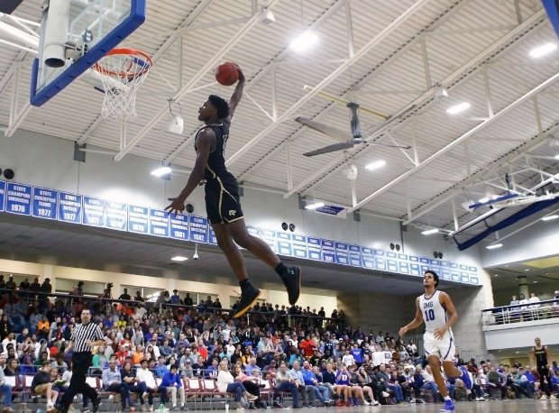 Edwards rises for a dunk against IMG Academy